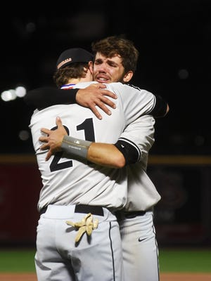 Kaden Smith, left, hugs teammate Colten Hursey after a 1-0 loss to Coldwater in the Division III state championship game in 2019 at Akron's Canal Park. Smith and Hursey were two of 10 seniors due to return for 2020 before COVID-19 ended the season before it started.
