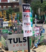 Presidential candidate signs adorn a Cedar Rapids sidewalk Sunday.