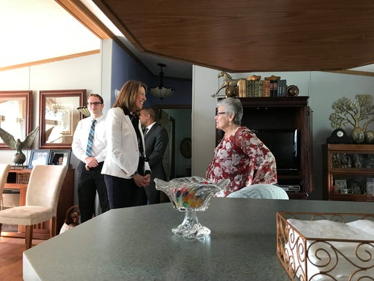 Waukee resident Lois Garwood, right, meets with U.S. Rep Cindy Axne, D-Iowa, in her mobile home on Monday. Axne on Monday sent a letter to the company that bought Midwest Country Estates in Waukee, asking for more information about its business.
