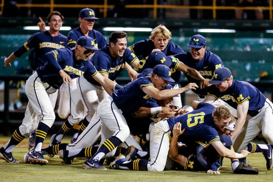 Michigan players celebrate after they defeated UCLA during the ninth inning of an NCAA college baseball tournament super regional game in Los Angeles, Sunday, June 9, 2019. Michigan won 4-2.