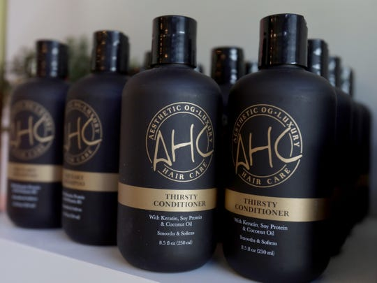 Some of the Aesthetic Hair Co. hair products on the shelf at the salon co-owned by Alex Pardoe, 25.