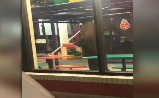 Burger King is retraining workers in a Florida franchise after an employee was caught on video cleaning a table with a floor mop.