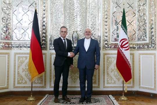 Iranian Foreign Minister Mohammad Javad Zarif, right, and his German counterpart Heiko Maas shake hands for the media prior to their meeting, in Tehran, Iran, Monday, June 10, 2019.