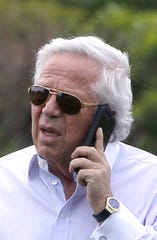 New England Patriots owner Robert Kraft speaks on a phone during an NFL football minicamp practice.