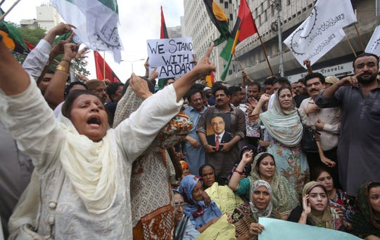 Supporters of Pakistan's former President Asif Ali Zardari protest to condemn his arrest, in Karachi, Pakistan, Monday, June 10, 2019.