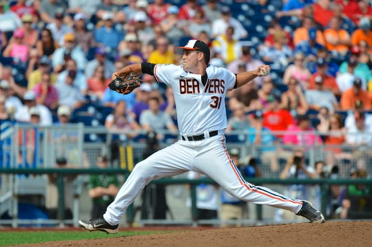 Matt Boyd pitches for Oregon State in the 2013 College World Series.