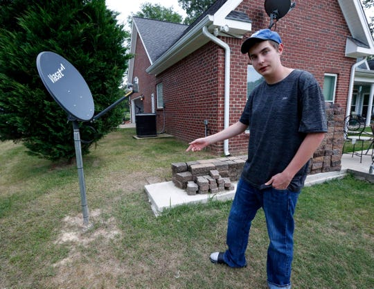 Riley Shaw talks about his family's internet at his home outside Starkville, Miss.
