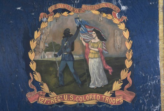 This undated photo provided by Morphy Auctions shows a 127th Regiment United States Colored Troops battle flag in Denver, Pa.