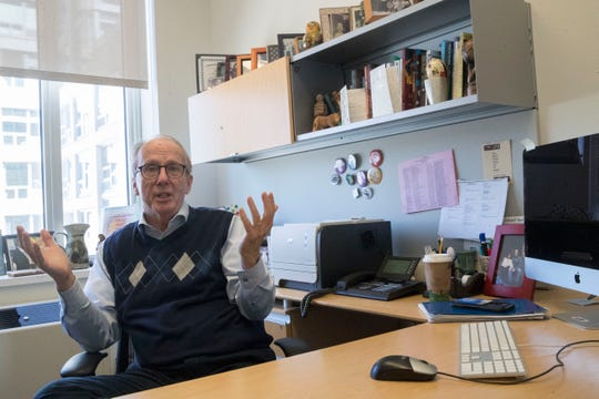 Steve Burghardt, a professor of social work at the City University of New York, gestures as he speaks in his office at Hunter College's Silberman School of Social Work.