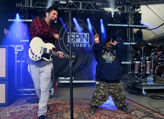 In this March 18, 2016, photo Bushwick Bill, right, joins Deftones' Chino Moreno onstage at the SPIN Party at Stubb's during the South by Southwest Music Festival in Austin, Texas.