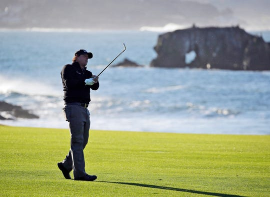 Phil Mickelson hits from the 18th fairway of the Pebble Beach Golf Links during the final round of the AT&T Pebble Beach Pro-Am earlier this year.