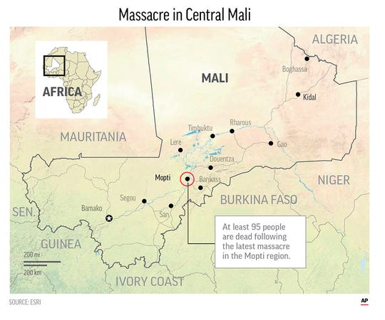 Unknown assailants killed at least 95 people in an ethnic Dogon village overnight.