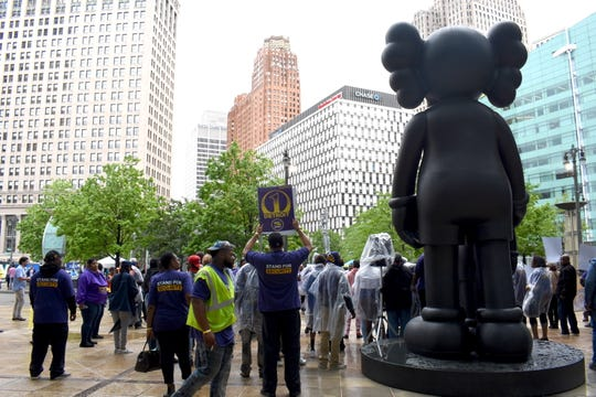 Supported by SEIU local 1 janitors and elected officials, downtown Detroit security officers announce a strike against SecurAmerica over unfair labor practices during a press conference in Campus Martius, Monday.