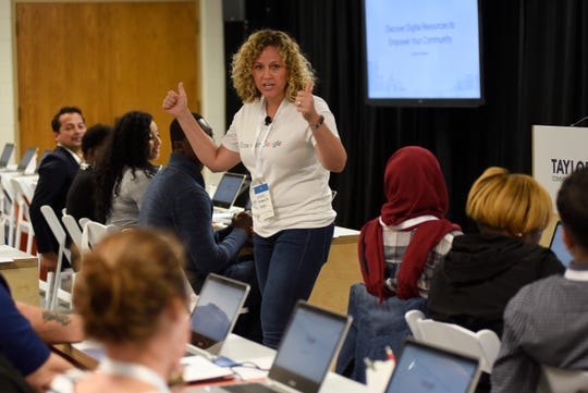 Whitney Cox, who works with the Grow With Google program, talks to workshop attendees Monday at the Taylor Community Library. In addition to training nonprofits and others in Google tools, the technology giant will invest more than $17 million into its Detroit and Ann Arbor facilities as it adds jobs.