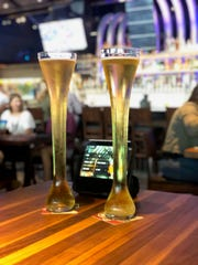 The Yard House in Troy serves beers in 32-ounce glasses that are a foot and a half tall.