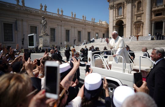 Pope Francis leaves at the end of his general audience in St.Peter's Square at the Vatican.