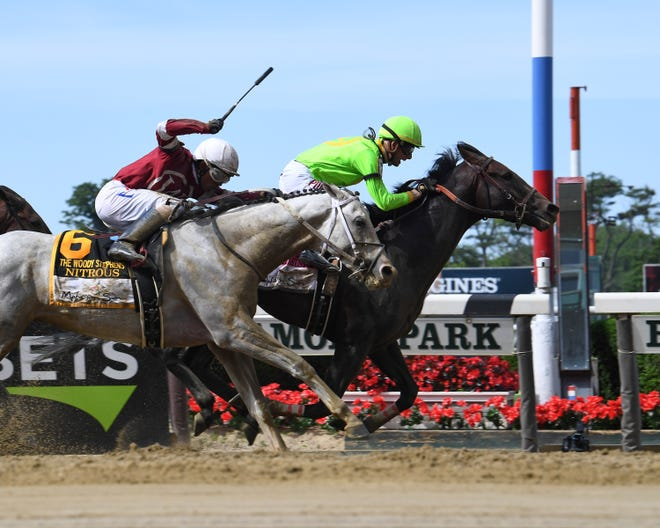 Hog Creek Hustle wins the Woody Stephens Stakes at Belmont Park Saturday by a neck over Nitrous.