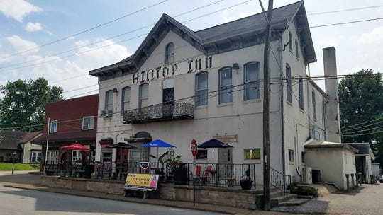 The Hilltop Inn building has stood atop its West Side hill since 1857.