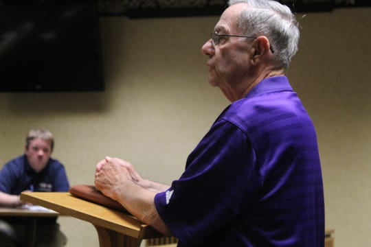 Fremont resident Dennis Hasslebach speaks to Fremont City Council members Thursday and voices his opposition to an ordinance to rezone parcels for a proposed apartment complex on Mulberry Street from R-1 to R-3. The council approved the ordinance by a 4-2 vote.