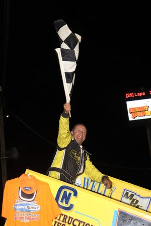 John Ivy celebrates in Victory Lane after taking his 57th career feature win Saturday at Fremont Speedway.