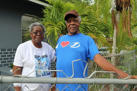 Charlie Cosby and and Evelyn McDonald (in background) stand outside Cosby's home in Fort Myers. Cosby said he put the home under a reverse mortgage and was threatened with foreclosure because of an insurance dispute. The retired agricultural worker hired a lawyer and the case was dismissed.