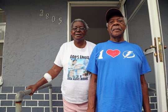 Charlie Cosby and Evelyn McDonald stand outside Cosby's home in Fort Myers. Cosby said he put the home under a reverse mortgage and was threatened with foreclosure because of an insurance dispute. The retired agricultural worker hired a lawyer and the case was dismissed.