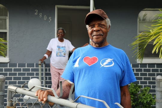 Charlie Cosby and and Evelyn McDonald (in background) stand outside Cosby's home in Fort Myers. Cosby put the home under a reverse mortgage and was threatened with foreclosure because of an insurance dispute, he shared. The retired agricultural worker hired a lawyer and the case was dismissed.