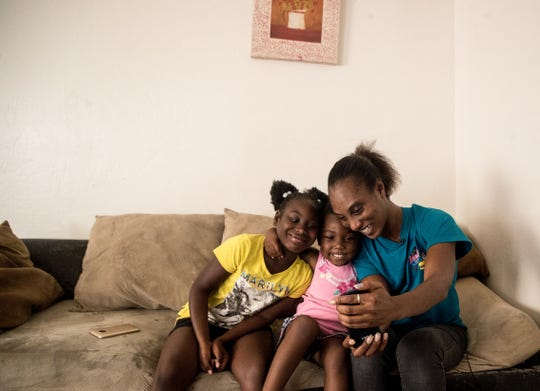 Chiquita Robinson and her daughters Kashlen Smith, 3, and Deajah Wilson, 8, take a selfie in their Sunrise Towers apartment. Even with two jobs, the family gets assistance through the housing program known as Section 8. She is concerned because she must use her voucher or lose it by July.