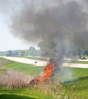 Fire destroys a  car in the ditch along Highway 41 near County Highway J on May 31.