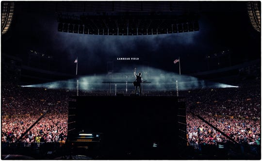 Paul McCartney looks out at a sold-out crowd at Lambeau Field from atop a raised platform on the stage of his Freshen Up Tour on June 8.