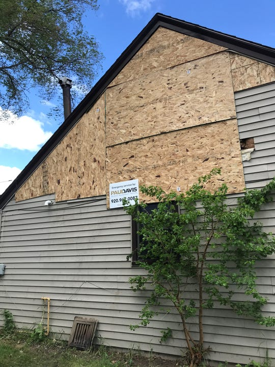 The back of the house at 2519 Wisconsin Ave., is boarded up following a house fire Friday morning.