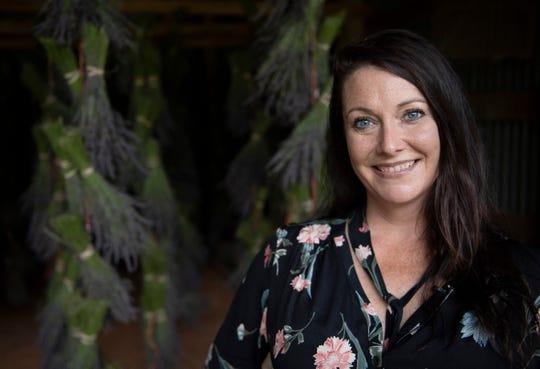 Michelle Ducworth runs at Twin Creeks Lavender Farm in Williamston.