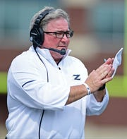 Akron Zips head coach Terry Bowden claps in the third quarter against the Iowa State Cyclones at InfoCision Stadium.
