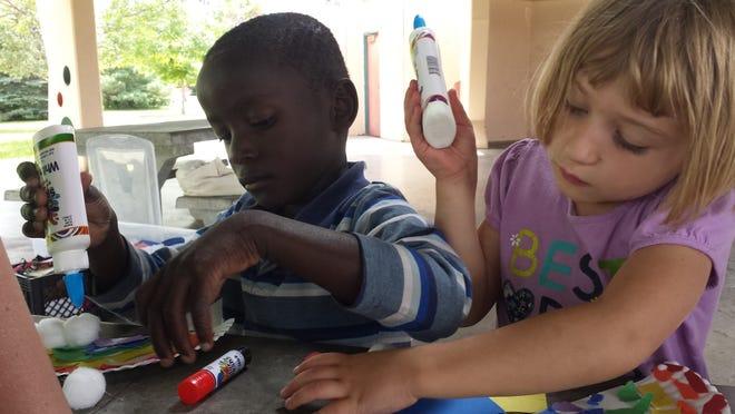 Children enjoy the Park Pals program last summer at Lion's Park.