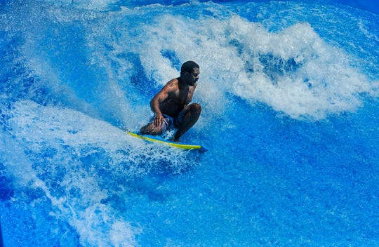 Michael Williams makes the first ride of the summer at the Flow Rider at Electric City Water Park, where the bathhouse facilities have been remodeled for roughly $650,000.
