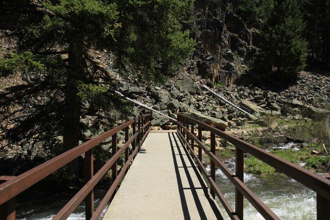 Crossing the bridge over Belt Creek at Memorial Falls Trail
