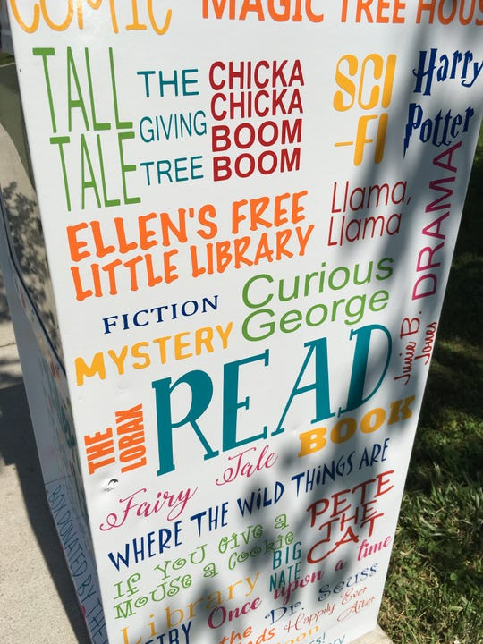 Ellen Chaney's Little Free Library is useful and pretty. Her mom helped her decorate it with book genres and titles.