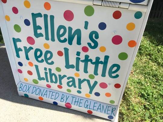 The front of Ellen Chaney's Little Free Library in Central Park, which was formerly a newspaper vending machine.