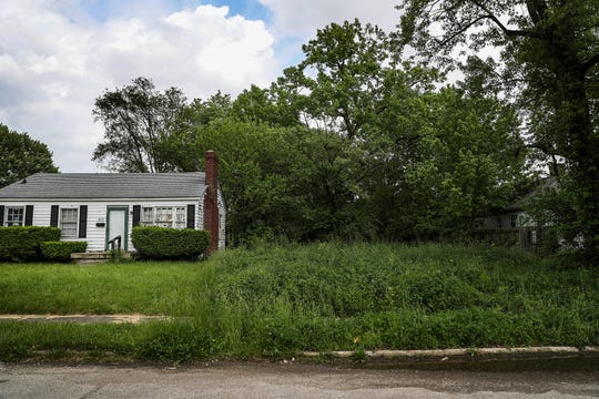 "An empty lot at 3311 N. Colorado Ave. is seen Thursday, May 23, 2019, where an abandoned house was demolished as part of Mayor Joe Hogsett's 2000 Homes Initiative, which aims to ""rehab, transform or demolish homes"" in Indianapolis in an effort to reduce crime. ""It was full of water, raccoon infested, the roof collapsed in,"" neighbor Candace Robinson said. ""The next strong wind, it was going to come down."""