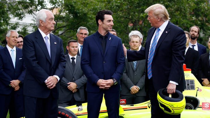 President Donald Trump stands with team owner Roger Penske, left, and driver Simon Pagenaud on the South Lawn at the White House, Monday, June 10, 2019, in Washington as he honors Team Penske for the 2019 Indianapolis 500 win.