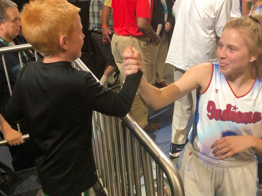 Maddie Nolan greeted Isaac Antcliff, son of Zionsville Athletic director Kelly Antcliff on Saturday after the   Indiana All-Star game vs. Kentucky.