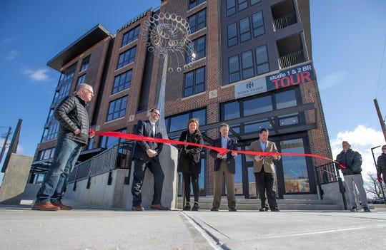 Indianapolis Mayor Joe Hogsett and othercut the ribbons officially opening the new The River House apartment complex at 6311 Westfield Boulevard, Indianapolis.