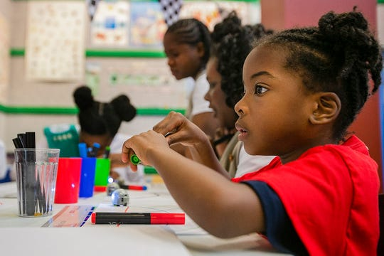 Girls Scout Cecil Khadijah Minatagbe Diakite Kariessy looks up at her sister during an activity, Wednesday May 29, 2019, at the Girls Scouts Math and Science Center at Dellwood Camp, Indianapolis. Each activity encouraged young girls use skills in math and science.