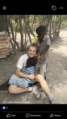Maddie Nolan played with local children during one of her trips to Haiti.