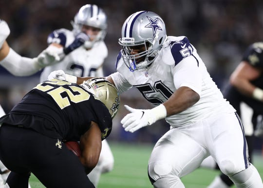 Nov 29, 2018; Arlington, TX, USA; New Orleans Saints running back Mark Ingram (22) runs with the ball against Dallas Cowboys defensive tackle Caraun Reid (51) at AT&T Stadium.