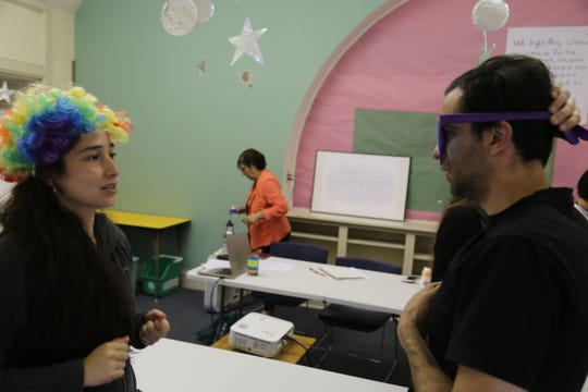 Nadia Bastias and Ivan Foddanu do a practice drill in an English as a second language course.