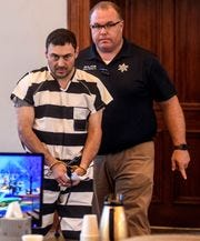 Oxford Police Officer Matthew Kinne, center, is escorted into a hearing by Lafayette County Sheriff Dept. Maj. Alan Wilburn at the Lafayette County Courthouse, Wednesday, May 22, 2019, in Oxford, Miss.