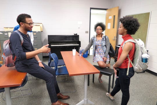 After attorney Jeffrey Graves' seminar on entertainment law at JSU, students linger to ask questions and receive answers that will hopefully benefit them in the music industry one day.