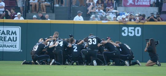 The Mississippi State baseball team prays ahead of Sunday's super regional game in Starkville against Stanford.