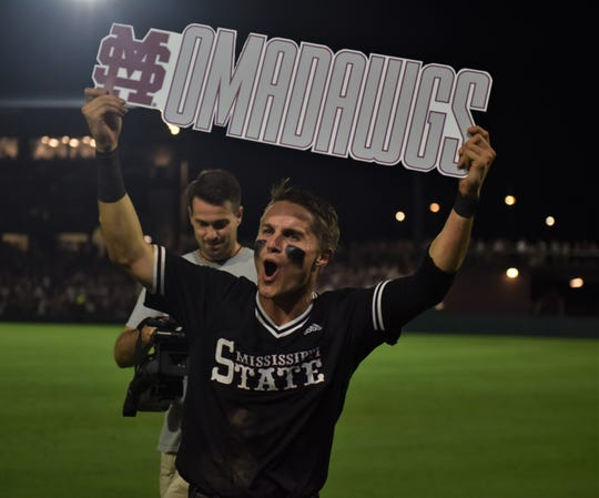"Jake Mangum celebrates with an ""Omadawgs"" after Mississippi State defeated Stanford 8-1 in Game 2 of the Super Regionals on Sunday, June 9, 2019, in Starkville."